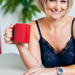 Relaxed woman in lingerie enjoying her beverage — Stock Photo