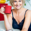 Attractive woman enjoying coffee and reading magazine — Stock Photo #19567145