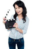 Joyous woman with clapperboard — Stock Photo