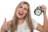 Excited girl holding old fashioned alarm clock — Stock Photo