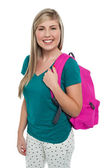 Teen posing with pink backpack — Stock Photo