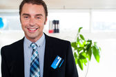 Handsome business executive smiling at the camera — Stock Photo