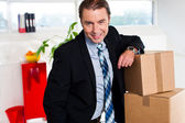 Middle aged businessman at his relocated office — Stock Photo