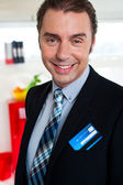 Cheerful male business executive in formals — Stock Photo