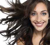 Sexy young fashion model with flying hair — Stock Photo