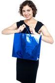 Shopaholic female holding shopping bag — Stock Photo