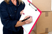 Sign here please and accept delivery of goods — Stock Photo