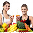 Smiling girls holding juicy slice of an orange - Stockfoto