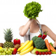 Beautiful woman hiding her face with spinach - Stock Photo