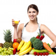 Stock Photo: Young womwith fruits and glass of juice