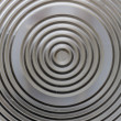 Circular classy aluminium surface — Stock Photo #24550535