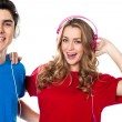Adorable young couple enjoying music — Stock Photo #24550863