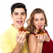 Stock Photo: Couple posing with pizza slice, about to eat