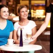 Two beautiful young girls at coffee shop — Stock Photo