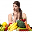 Mischievous look of a young woman with fruits — Stock Photo