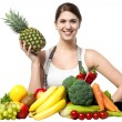 Beautiful young woman with fruits and vegetables — Stock Photo
