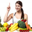 Young smiling woman with fruits and vegetables — Stock Photo