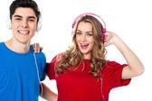 Adorable young couple enjoying music — Stock Photo