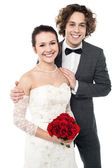 Excited groom embracing beautiful bride — Stok fotoğraf