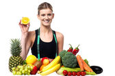 The beautiful girl with fruits and vegetables — Stock Photo