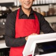 Cheerful barista staff at the cash counter - Foto Stock