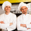 Smart and confident male chefs — Stock Photo