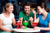 Three friends enjoying tempting dessert — Stock Photo