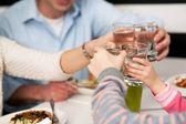 Family toasting water glasses in celebration — Stock Photo
