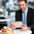 Business executive at open restaurant — Stock Photo #24593431