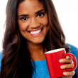 Smiling woman with coffee mug — Stock Photo