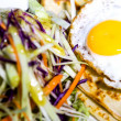 Fried egg and coleslaw, rich breakfast — Stock Photo