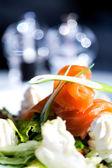 Smoked salmon with cream and salad — Stock Photo