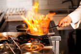 Chef cooking in kitchen stove — Stock Photo