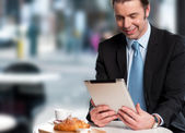 Handsome manager reviewing business updates — Stock Photo