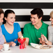 Happy family of four in restaurant — Stock Photo