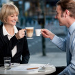Business partners toasting coffee at cafe — Stock Photo