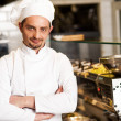 Confident young chef posing — Stock Photo