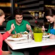 Family enjoying meal outdoors — Stock Photo