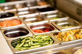 Delicious vegetarian food in trays — Stock Photo