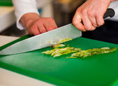 Chef chopping leek and doing preparations — Stock Photo