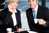 Two business professionals at coffee shop — Stock Photo