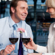 Royalty-Free Stock Photo: Happy couple toasting red wine