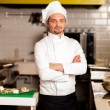Stock Photo: Confident young chef posing