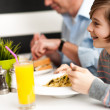 Dad and son in restaurant — Stock Photo