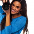 Stock Photo: Womtaking snap, smile please