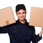 Smart courier boy delivering parcels — Stock Photo #25303221