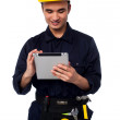 Field worker accessing touch pad — Stock Photo