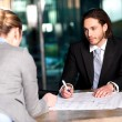 Colleagues discussing business plan — Stock Photo