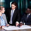 Employer explaining business plan to his colleagues — Stock Photo