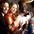 Group of friends at the bar, cheers to all... — Stock Photo